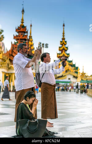 Myanmar (formerly Burma). Yangon. (Rangoon). The Shwedagon Pagoda Buddhist holy place is the first religious center - Stock Photo