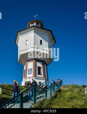 Wasserturm Langeoog. Germany Deutschland.  Holiday makers walking down the steps as the leave the water tower, which - Stock Photo