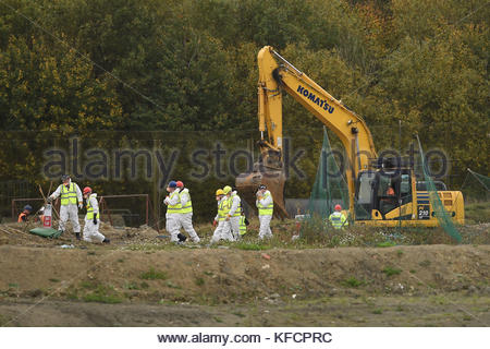 File photo dated 23/10/17 of police searching a new area of a landfill site in Milton, Cambridgeshire, for missing - Stock Photo