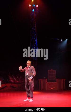 circus performers stripey trousers and hat - Stock Photo