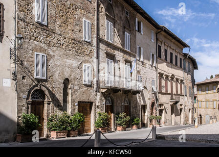 TUSCANY-JUNE 2:  view of a typical street in the town of  San Quirico ,Orcia valley,Tuscany,Italy,on june 2,2017. - Stock Photo