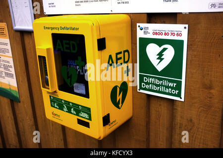 A defibrillator on the wall of a cafe in Mid Wales - Stock Photo