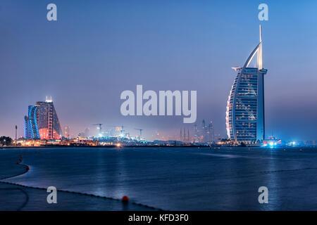 Dubai city viewed from the Palm Jumeirah - Stock Photo