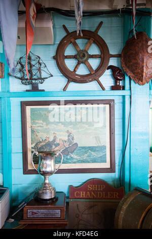 EXUMA, Bahamas. Interior of the Staniel Cay Yacht Club. Dining room and assorted maritime memorablilia. - Stock Photo