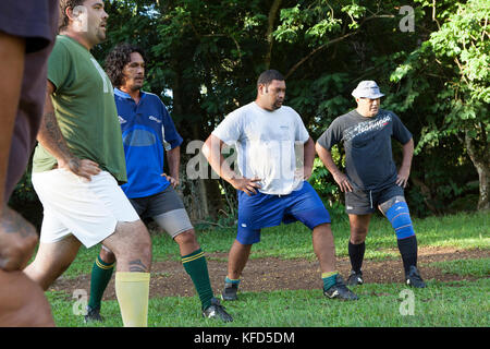 FRENCH POLYNESIA, Moorea. A local rugby team called Team Rotui practicing at Uop honu Park in Moorea Island. - Stock Photo