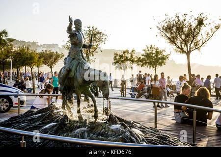 Don Quixote and Sancho Panza fountain statue, de Cervantes Plaza, Concha Beach promenade on a late summer afternoon, - Stock Photo