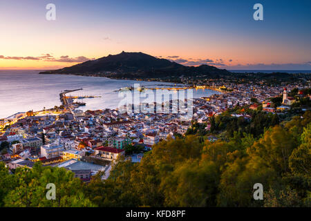 Sunrise over Zakynthos town and its harbour, Greece. - Stock Photo