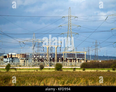 A National Grid  electrical switching sub-station on the 400kV overhead power transmission system with pylons for - Stock Photo