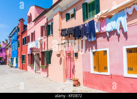 VENICE ITALY VENICE Colourful houses along a canal on the Island of Burano Venice lagoon Metropolitan City of Venice - Stock Photo