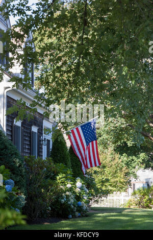 An American flag displayed in front of a Chatham,Massachusetts home.