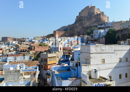 Cityscape of Jodphur with traditional indigo blue and white painted houses and the 15th century Mehrangarh Fortress on the hilltop.