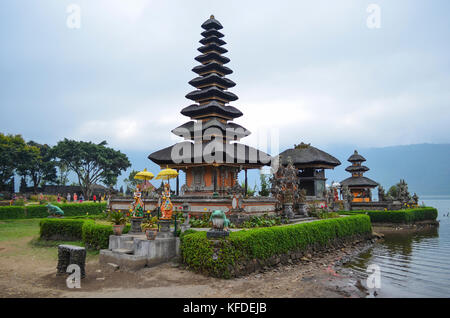 Balinese Hindu Temple, Ulu Danu Beratan, traditional architecture and tall towers with tiered tapering roofs in - Stock Photo