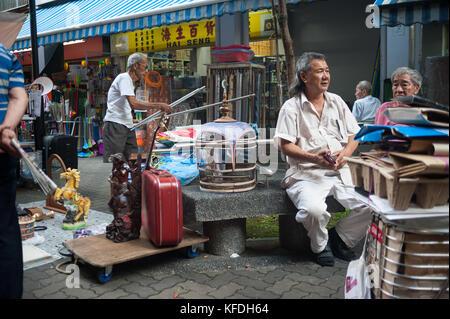 22.10.2017, Singapore, Republic of Singapore, Asia - People meet on Sundays at a small flea market near the Buddha - Stock Photo