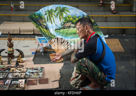 22.10.2017, Singapore, Republic of Singapore, Asia - A man offers Buddhist accessories for sale at a small flea - Stock Photo