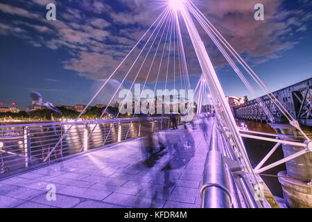 Ghosts on Jubilee Bridge at night,London,United Kingdom,summer 2017. - Stock Photo