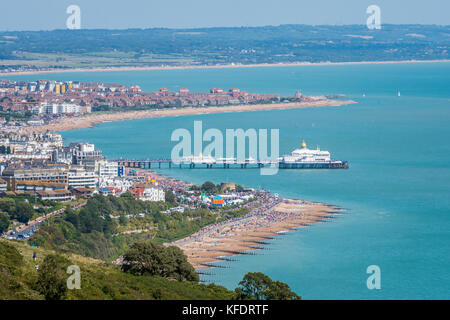 Aerial view of Eastbourne seafront, promenade, pier and English Channel from Beachy Head cliff top footpath - Stock Photo