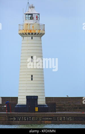 Lighthouse at Donaghadee (from Irish: Domhnach Daoi, meaning 'Daoi's church') is a small town in County Down, Northern - Stock Photo