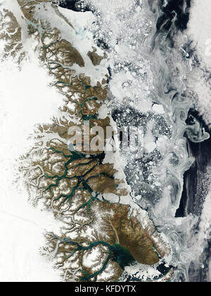 Summer thaw was underway on the fringe of eastern Greenland when this image was taken on July 13, 2007. Inland (left), - Stock Photo