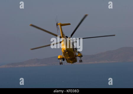 Sea King Helicopter air sea rescue exercise flying off Baggy point ,Croyde,Devon - Stock Photo