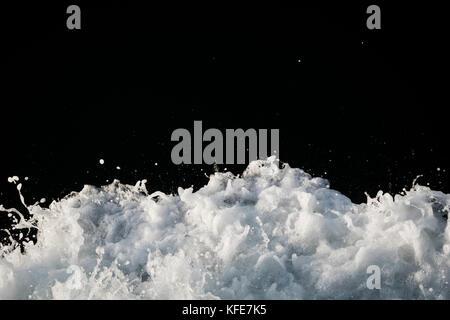 White water foam on dark water. Paired with KFE7K6. - Stock Photo