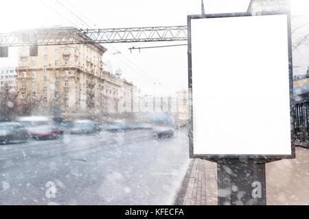 Empty  blank billboard in winter in snowfall, Christmas presentation design - Stock Photo