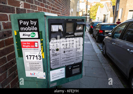 A vandalised Ringo parking meter in the LOndon Borough of Hammersmith and Fulham, UK. - Stock Photo