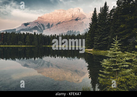 Two Jack Lake with mountain reflections along the Two Jack Lake  - Stock Photo