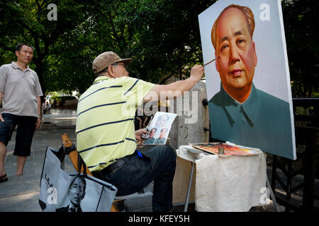 The artist paints a portrait of the Chinese leader Mao Zedong in the park in Guilin City Park, Guangxi Province, - Stock Photo
