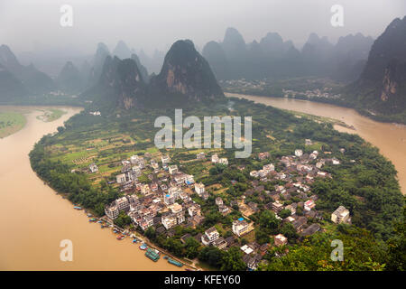 Panoramic view from the high hill near the Xingping old town to the Li River and the famous karst mountains in China - Stock Photo