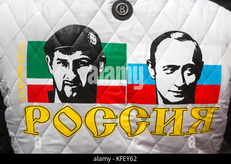 Portraits of Ramzan Kadyrov and Vladimir Putin on the back of the activist of the movement 'Antimaydan' during the - Stock Photo