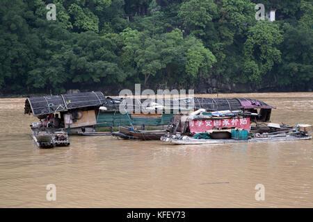 A floating village on the Li River near Yangshuo city in Guangxi Zhuang Autonomous Region of China - Stock Photo