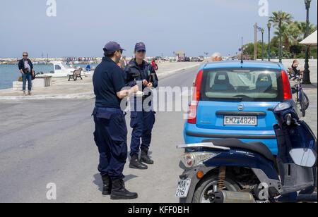 Greek traffic police at a car parking at no waiting, Naxos-town, Naxos island, Cyclades, Aegean, Greece - Stock Photo