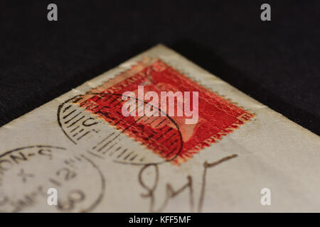 Old British empire stamp - Penny red on an 1860's envelope - Stock Photo