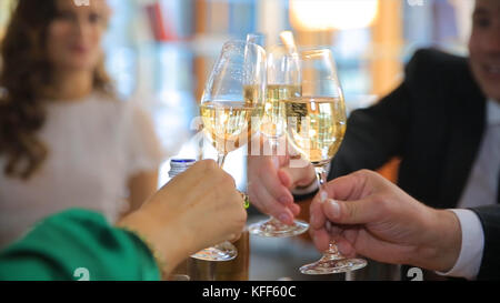 Hands holding glasses and toasting, People cheers with a glass of champagne. happy festive moment, luxury celebration - Stock Photo