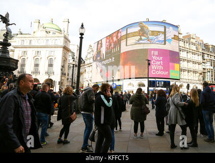 Piccadilly Circus. London. UK 28 Oct 2017 - Tourists in Piccadilly Circus on a sunny but cold day as Britain says - Stock Photo