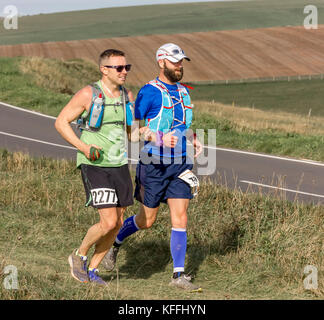 Beachy Head, Eastbourne, East Sussex, United Kingdom. 28th October, 2017. Runners take part in the gruelling Beachy - Stock Photo