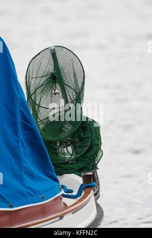 Fishing net on a boat - Stock Photo