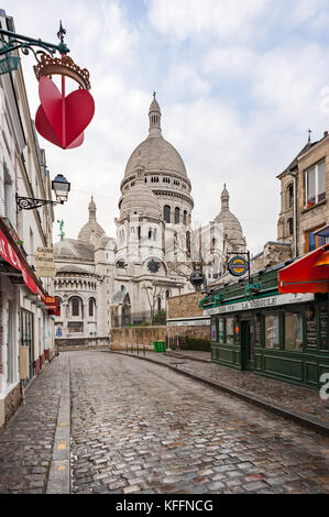 Early morning empty street in Montmartre with the Sacre-Coeur - Stock Photo
