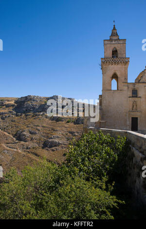 The campanile of the church of San Pietro Caveoso, and beyond, the ravine of the Gravina, Matera, Basilicata, Italy - Stock Photo