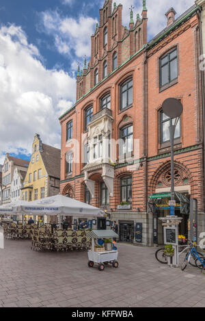 brick building of the trade house Hansen with gothic architecture elements at Nordermarkt square, coastal town Flensburg - Stock Photo