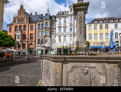 Nordermarkt square and the old brick building of the trade house Hansen,  Flensburg, coastal town at the Baltic - Stock Photo