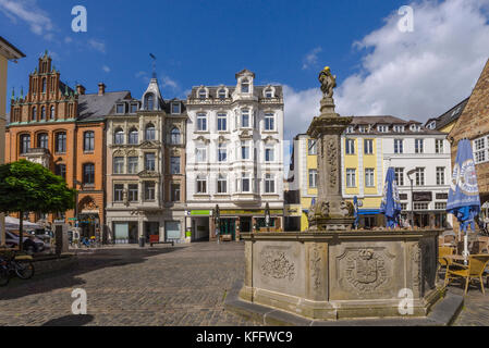 Nordermarkt square and the old brick building of the trade house Hansen in Flensburg, coastal town at the Baltic - Stock Photo