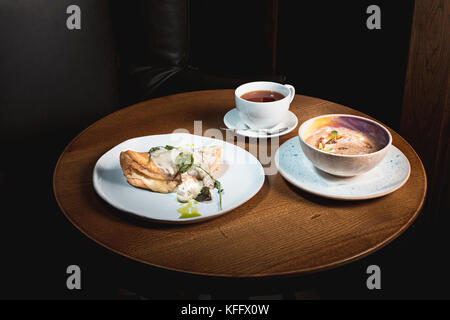 closeup of a plate with a typical tortilla de patatas, spanish omelet, on a set table - Stock Photo