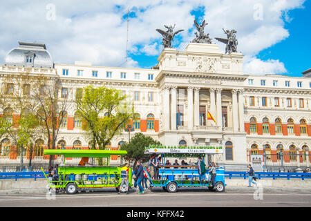 Beerbike vehicles and facade of Agriculture Ministry. Madrid, Spain. - Stock Photo