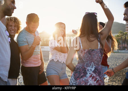 Portrait of young group of friends partying on beach - Stock Photo