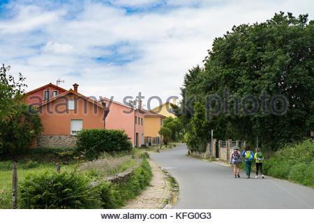 Three Women Walking the Camino Frances (The French Way), Santiago de Compostela, Spain - Stock Photo