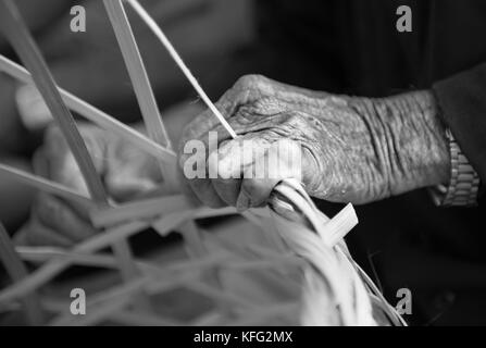 Old weavers hand, Hoi An, Vietnam. - Stock Photo