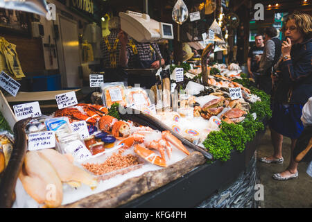various fish and shellfish on display in front of a fishmonger's shop, Borough Market, London. - Stock Photo