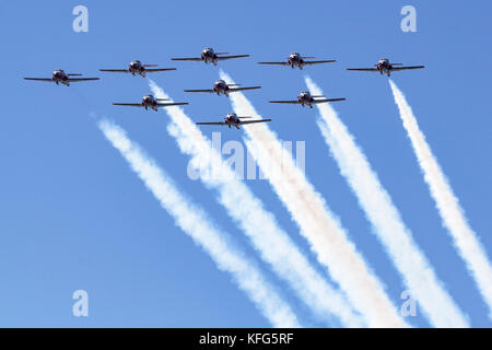 Nine CT-114 Tutor jets of the Canadian Snowbirds pass overhead in a diamond formation. The Snowbirds are part of - Stock Photo