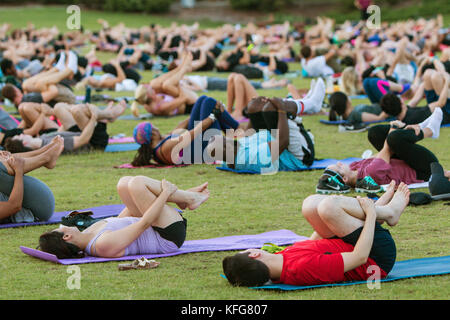 Atlanta, GA, USA - July 2, 2017:  Dozens of people do the wind running pose on their backs as they take part in - Stock Photo